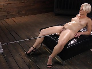 Oiled up solo fetish blonde model Helena Locke pounded hard by a machine