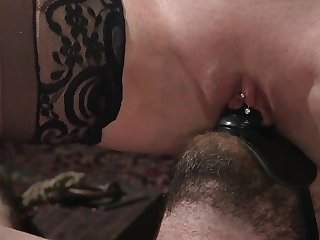 Dominatrix puts strapon on admirer's facet for riding