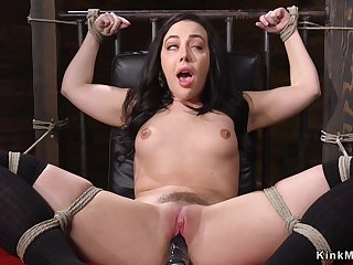 Tied up and gagged darkhaired babe fucks machinery