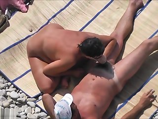 Voyeur Films A Stiffener Having Sex On The Beach