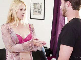 Oiled blonde is using her tits to give a hard- on to a challenge she likes