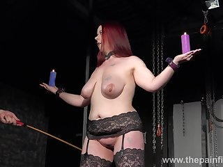 Chubby redhead has to endure some kinky punishment in the oubliette