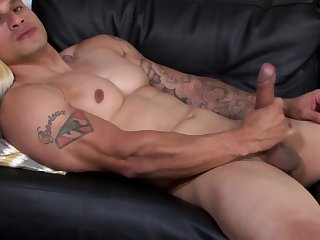 Hunky soldier enjoys stroking his big pecker