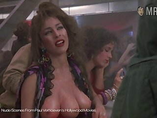 The three breasted hooker from Paul Verhoeven's movie window-dressing her assets