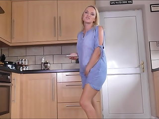 Sexy blonde pissing up ahead kitchen