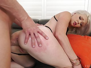 Hot blonde bends for the man's energized dick