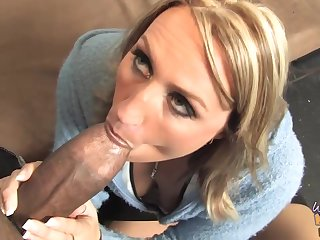 Busty blonde woman is eagerly sucking a fat, black cock and obtaining it from the back