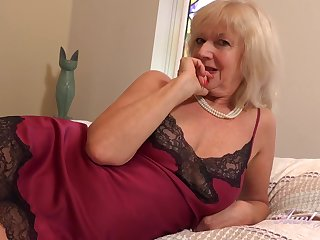 Aroused granny with blonde hair, Sapphire Louise doesnt mind masturbating up ahead be worthwhile for the camera