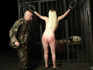 Sexy blonde prisoner Angel Spurt tied up and mouth fucked