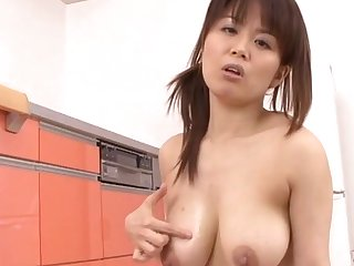 Sympathetic looking Japanese chick giving a nice titjob - Miki Sato